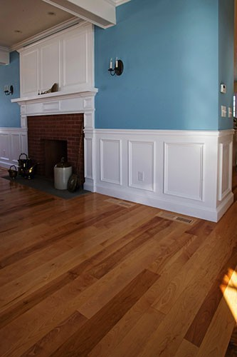 Painted Trim and Mouldings. Birch Floor.